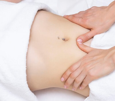 Person Receiving Abdominal Massage for Constipation