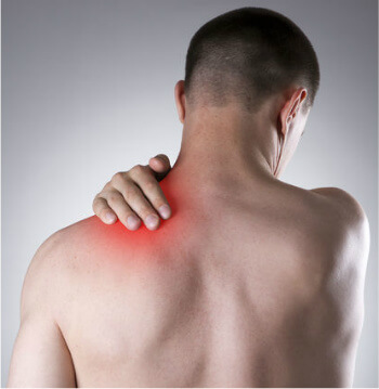 Man holding hand on a painful shoulder | Frozen Shoulder Pain Relief