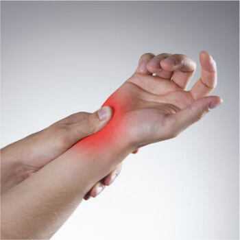 Person holding their painful wrist | Wrist Pain Relief