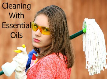 Woman With Cleaning Supplies | Cleaning With Essential Oils