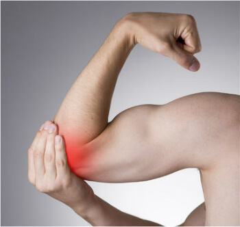 Man holding red spot around elbow indicating elbow pain.