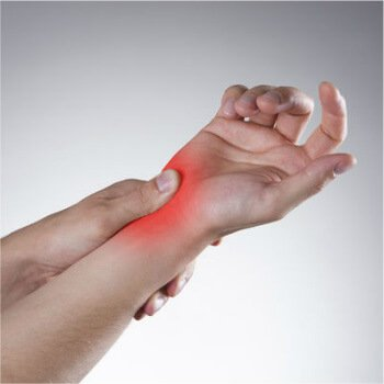 Person experiencing wrist pain